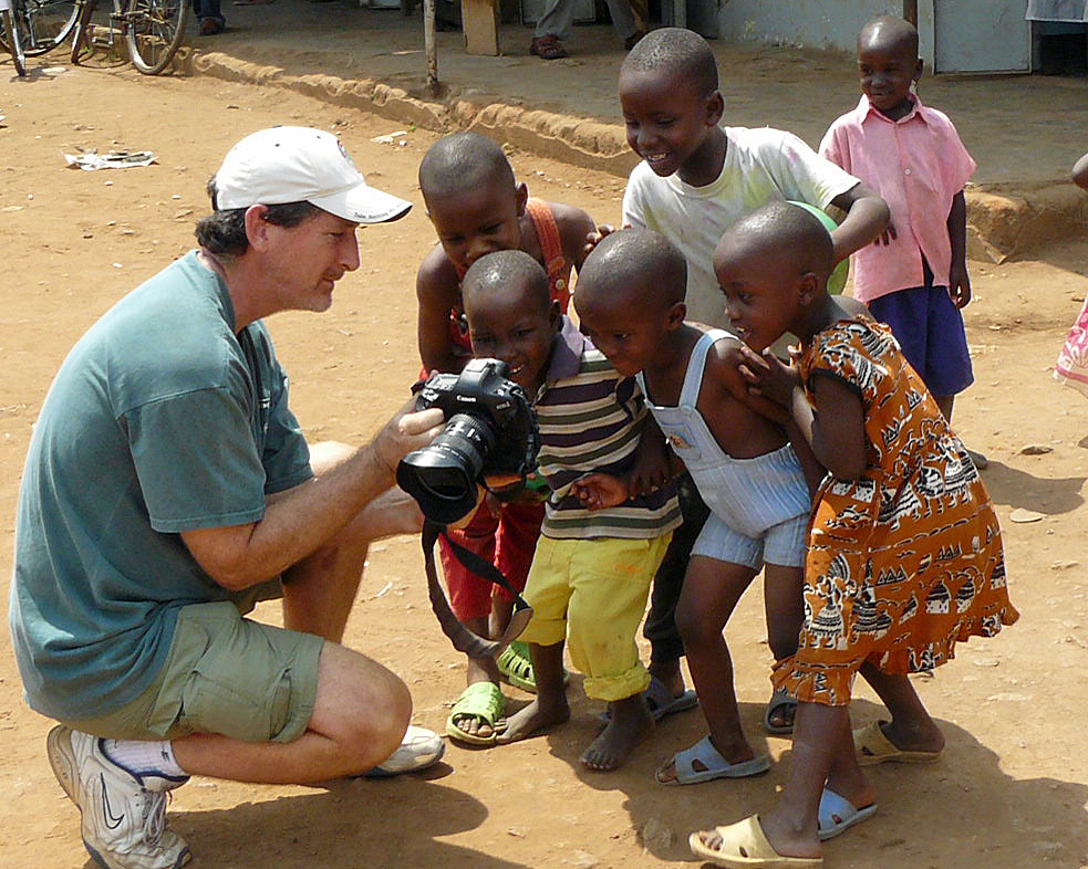 Walsh shows children in Uganda their photo for the first time.