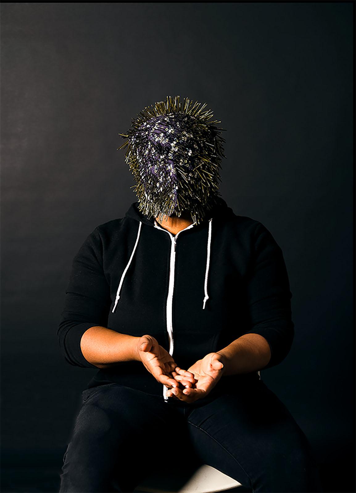 Touch It (Self Portrait), vinyl print, mask: reclaimed cotton head wrap, zipper, 1500 nails, 2018